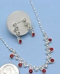 """Ruby"" CZ necklace and earring set."